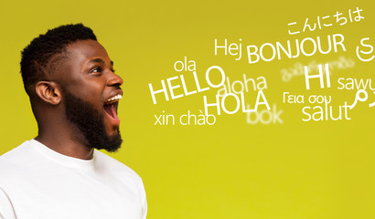 Young millennial afro man saying hello in many languages