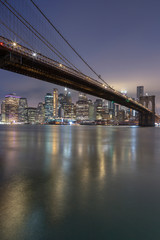 Brooklyn Bridge with Financial District at night with long exposure