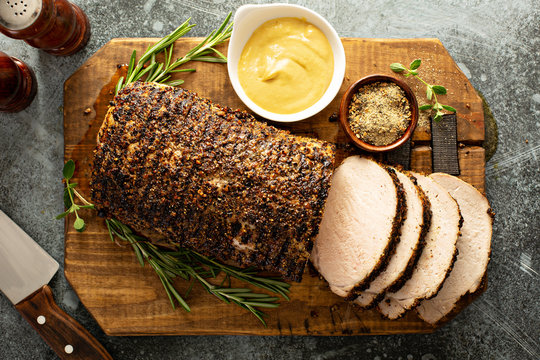 Roasted pork loin with a spicy rub and mustard sauce