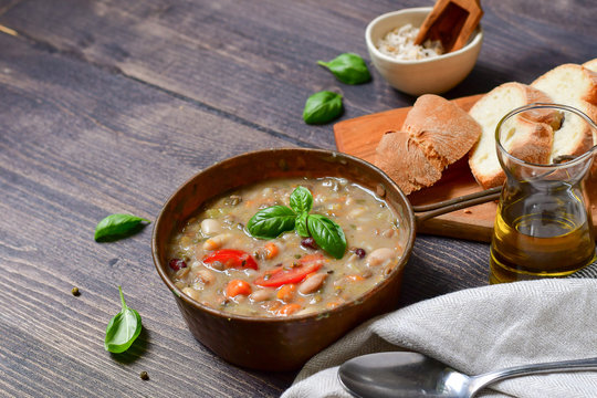 """Traditional Italian dish """"zuppa Toscana"""" from Tuscany ( Florence ) soup with different types of beans, carrots and vegetables. Vegan recipe. autumn winter food menu"""