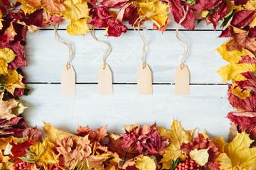 A blank tag sitting on a fall leaf background, fall harvest