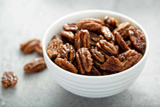 Caramelized or candied pecans for appetizer or salad in white bowl