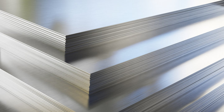 Steel or aluminum sheets in warehouse, rolled metal product.