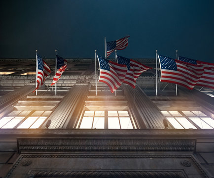 american flags in front of building flying patriot night look epic historic inspire memory loyal animate enforce assure call duty educe glory improve exalt better red illumine windows architecture art