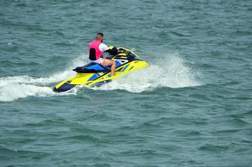 Garden Poster Water Motor sports Young man on a speeding yellow jetski