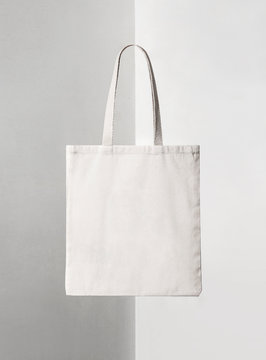 squared white tote bag on shadowed background