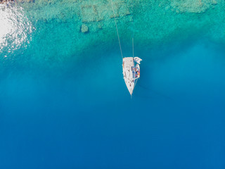 Sailing yacht moored to the shore, a delightful seascape drone photo.