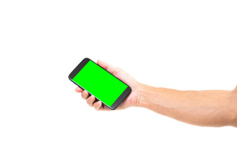 Man hand holding blank green screen smartphone on white background. Clipping path