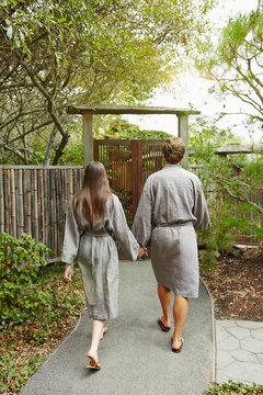 Couple walking down pathway at Japanese spa