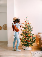 Mom and toddler in front of Christmas tree