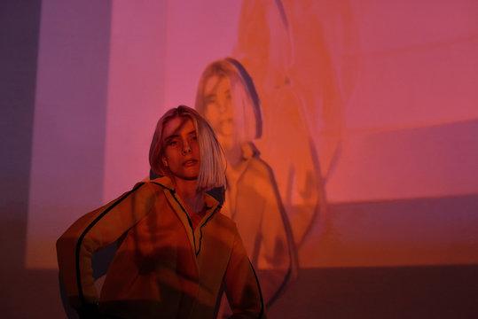 Model in overlay digital neon lights