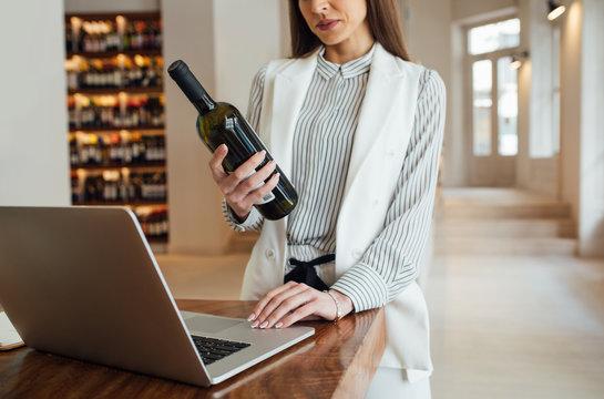 Businesswoman Working at Wine Shop