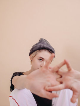 Portrait of young woman stretching fingers indoors
