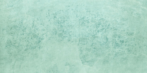 Pastel blue green background texture with grunge and old distressed and weathered rock or stone overlay design