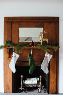 christmas stockings on fireplace mantle