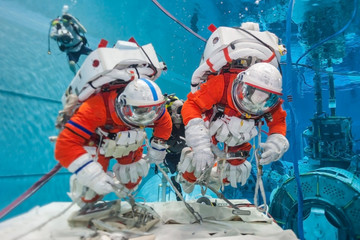Cosmonaut training in the pool, in spacesuits. Elements of this image were furnished by NASA