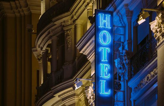 Illuminated hotel sign by night