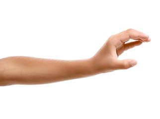Child's hand holding something on white background