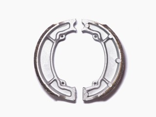 Motorcycle brake pads on a white background.