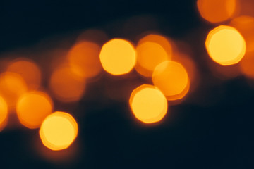 Abstract Gold bokeh sparkle on dark  background