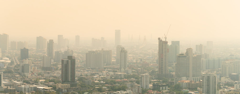 PM2.5 Unhealthy air pollution dust smoke in the urban city. Low visibility city view with dangerous haze and fog. Smog Bangkok city.