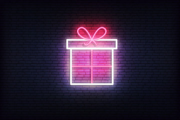 Gift box neon icon. Glowing Christmas winter holiday icon sign
