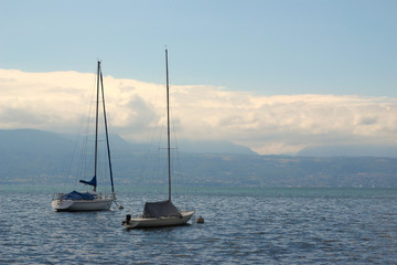 Two sailboats at anchor at the Lake Geneva in Lausanne, Switzerland, July 2019