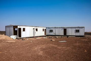 Abandoned construction trailers in the desert, Harrat Kishb, Saudi Arabia