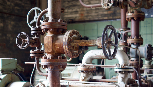 Large old rusted pipe valve