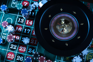 Roulette table and stack of poker chips. Casino, gambling and entertainment concept.