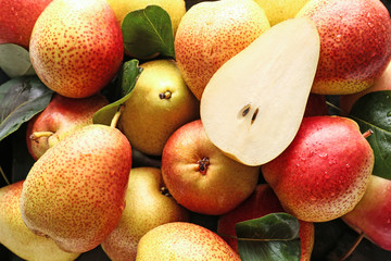 Many sweet ripe pears as background
