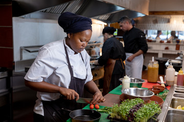 Chefs working in busy restaurant kitchen