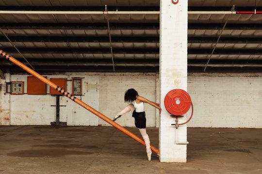 Female dancer in an empty warehouse