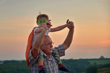 grandpa holding grandson. Family Relationship Between Grandfather and Grandson. Grandpa Teaching,