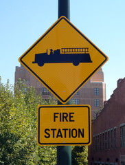 Fire truck symbol on yellow fire station street sign