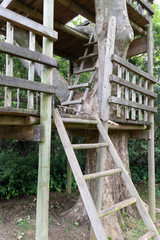 Wooden rustic treehouse for children to play in