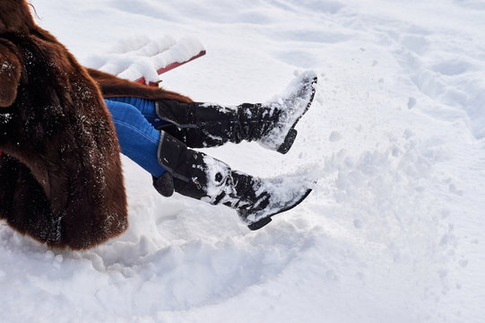 Women's winter boots in the snow.