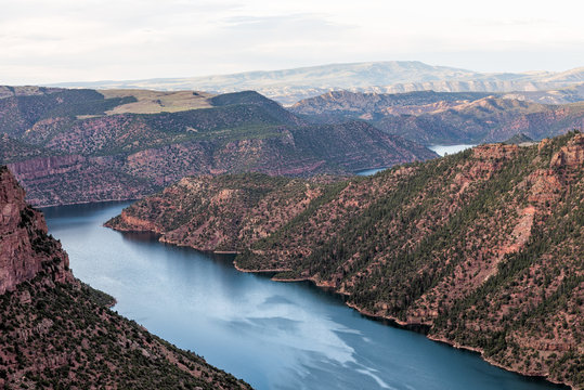 Aerial colorful view from Canyon Rim trail overlook near campground in Flaming Gorge Utah National Park with Green River at sunset