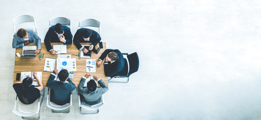 Top view on a group of businessman and businesswoman having a meeting and making a business...