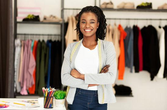 Black Clothing Designer Standing In Own Dressmaking Atelier