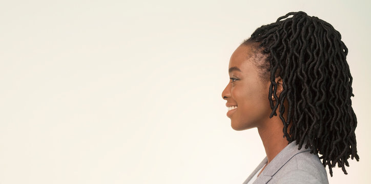 Studio Portrait Of Smiling African American Businesswoman, Side View, Panorama