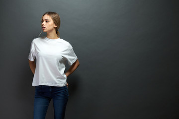 Sexy woman or girl wearing white blank t-shirt with space for your logo, mock up or design in casual urban style