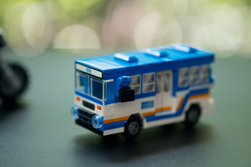 Miniature toy bus are one of the most important public transport system in Bangkok.