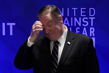 U.S. Secretary of State Pompeo scratches his forehead while being introduced by former U.S. Senator Lieberman during the United Against Nuclear Iran Summit in New York City