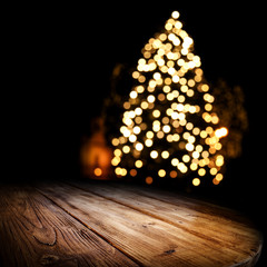 Dark wooden old table and chrismtas tree