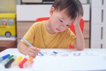 Cute Asian 3 - 4 years old toddler boy child writing / drawing with pencil, Student doing homework, Little kid prepare for kindergarten test, Creative play for toddler, improve focus in child concept