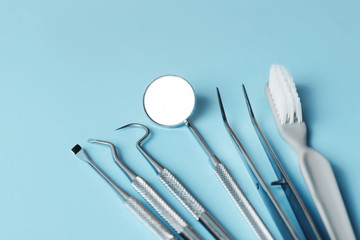 Wall Mural - dental tools on pink background top view