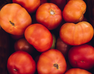 Bulk of red tomatoes in a fruit shop