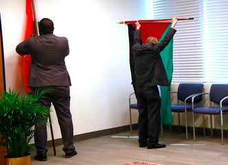Men prepare flags ahead of meeting between Iran's President  Rouhani and U.N. Secretary General Guterres on the sidelines of the 74th session of the United Nations General Assembly in New York City, New York, U.S.