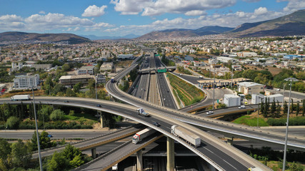 Aerial photo of multilevel junction highway overpass in urban area with beautiful sky and clouds